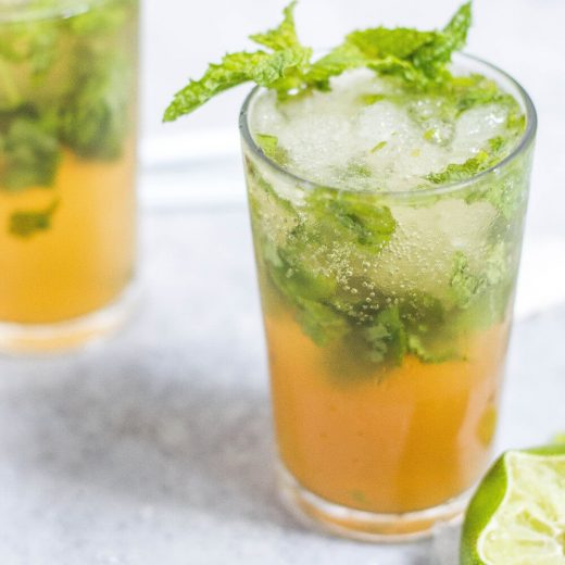 Glass with tea, ice, and mint leaves. Lime slice