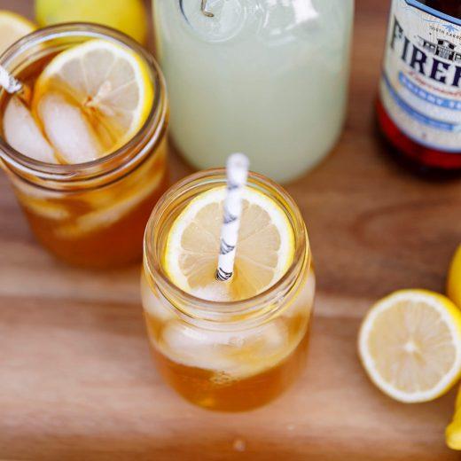 Cocktail glasses, lemonade pitcher, lemons