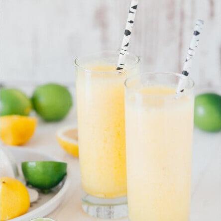 Glasses with lemonade, lime and lemon slices